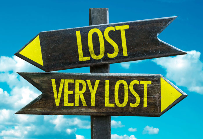 Sign showing an arrow facing left with the word lost and an arrow facing right with the words very lost