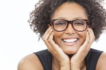 Woman smiling after visiting cosmetic dentist in Mill Creek WA