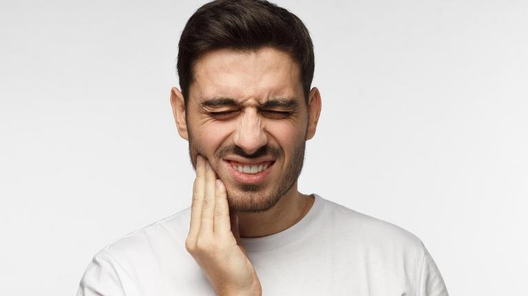 Man experiencing toothache in Mill Creek WA